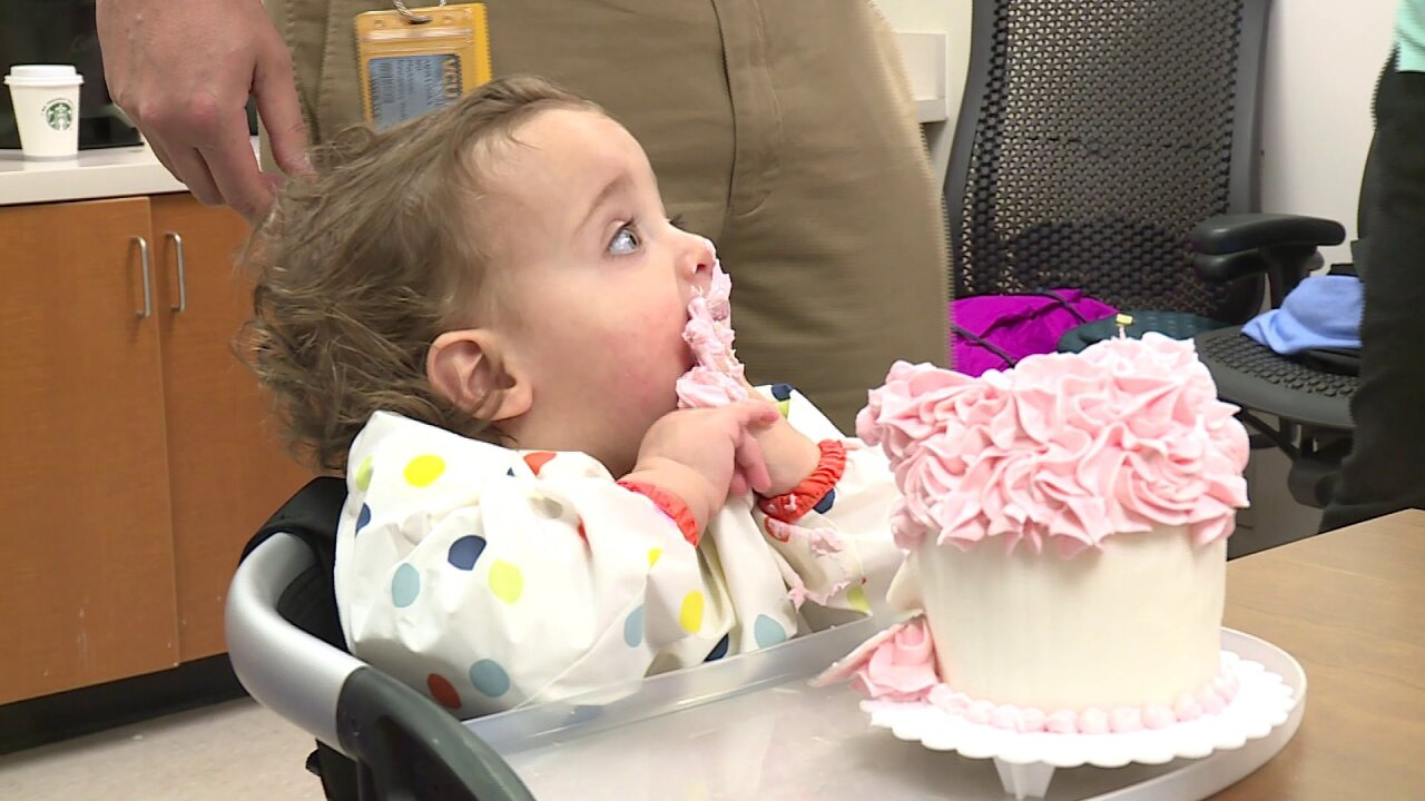 Family celebrates daughter's first birthday with VCU nurses and doctors who saved her life