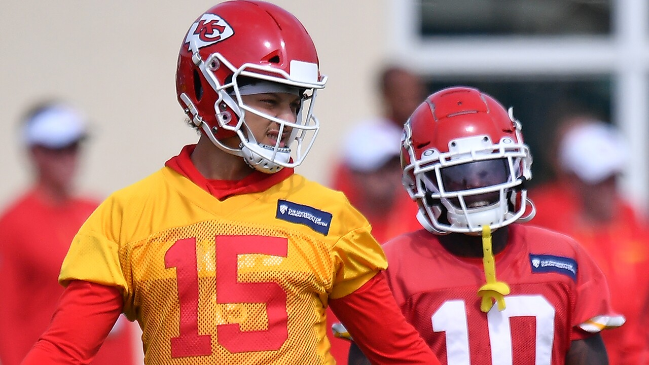 Patrick Mahomes #15 and Tyreek Hill #10 of the Kansas City Chiefs discuss plays during the Kansas City Chiefs practice prior to Super Bowl LIV at Baptist Health Training Facility at Nova Southern University on January 31, 2020 in Davie, Florida.