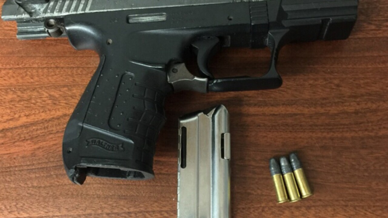 Two men arrested with loaded guns Monday