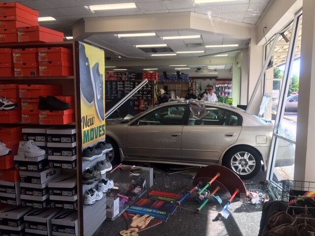 Photos: Vehicle crashes into Suffolk storefront