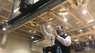 Forest Hills Northern head coach, Joe Soules cuts down the nets.
