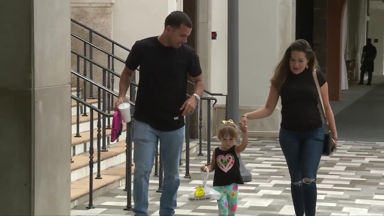 Erica Malagon and family walk through Rosemary Square