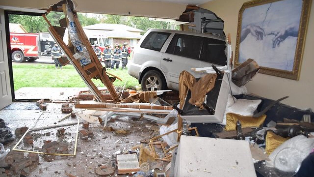 Family of 6 displaced when car plows into house