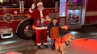Indiana boy who denied visit with Santa because of his service dog gets surprise visit