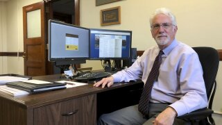 In this Friday, Jan. 10, 2020 photo Idaho Administrative Rules Coordinator Dennis Stevenson poses in his office in Boise. An animosity-tinged power struggle between the Idaho House and Senate has had big ramifications for Stevenson, who for three decades has toiled in an agency most people didn't know existed. (AP Photo/Keith Ridler)