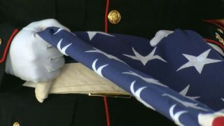 Soldier folding American flag