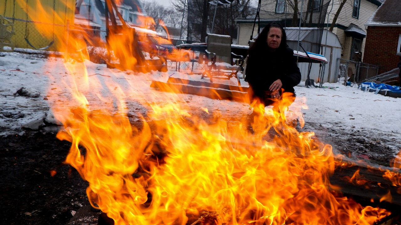 Virginia LaForce watches the bonfire grow in her Kenmore backyard. (Noor Hindi_The Devil Strip).jpeg