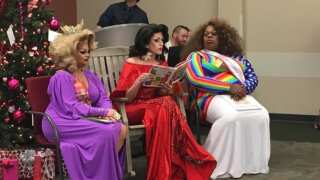 File photo of Drag Queens reading books to children, while protesters gather outside.
