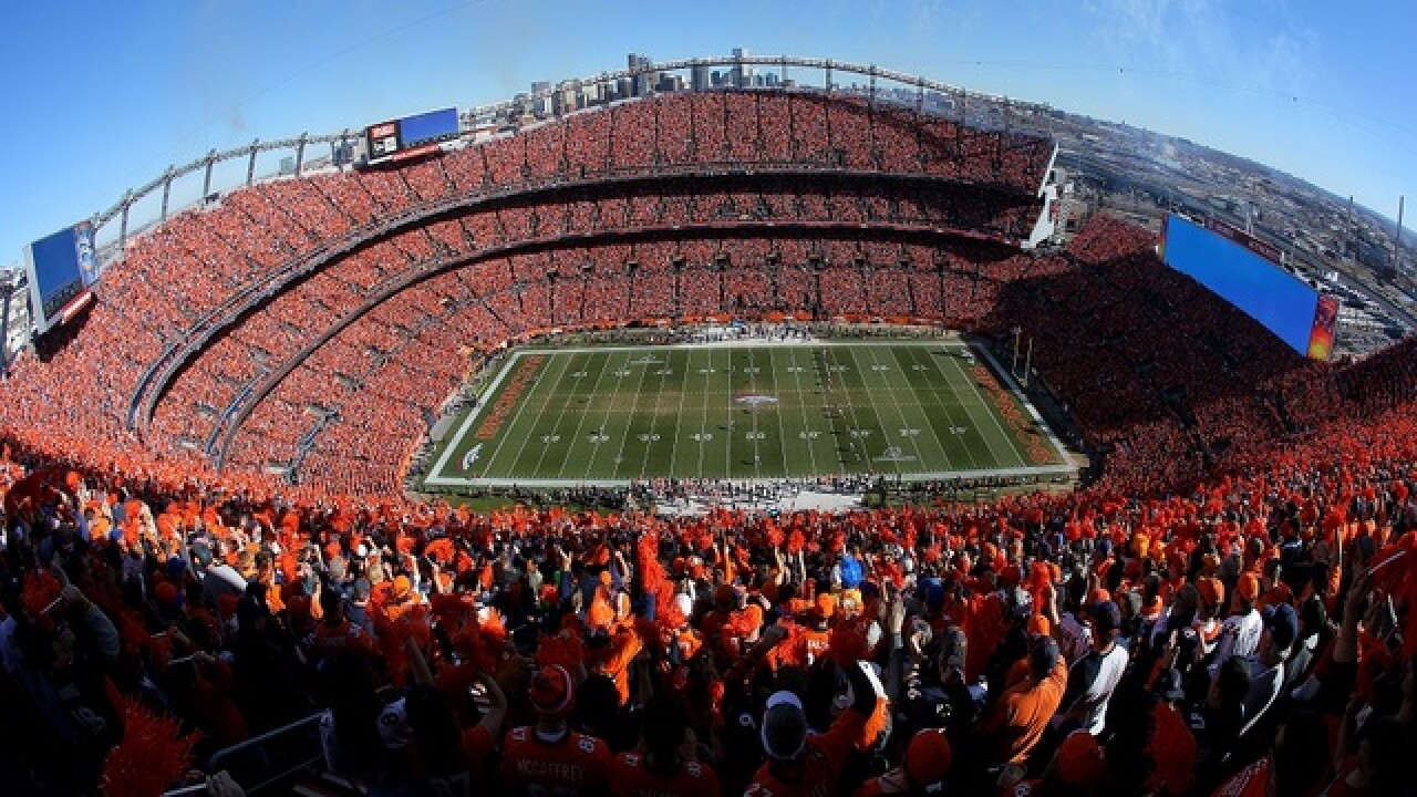 Fan dies after falling while leaving Broncos football game