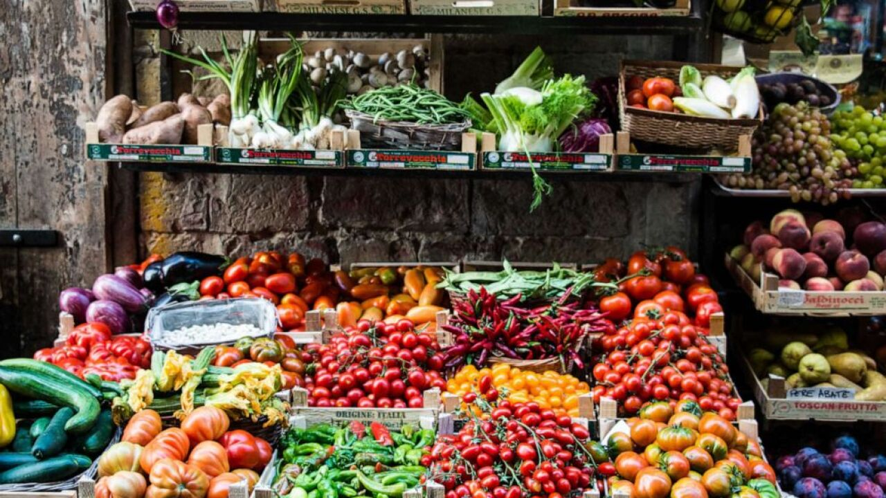 Produce are sold at an outdoor market in this stock photo.