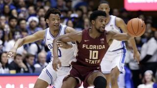 Florida State Seminoles forward Malik Osborne and Duke Blue Devils forward Wendell Moore Jr. chase basketball, February 2020