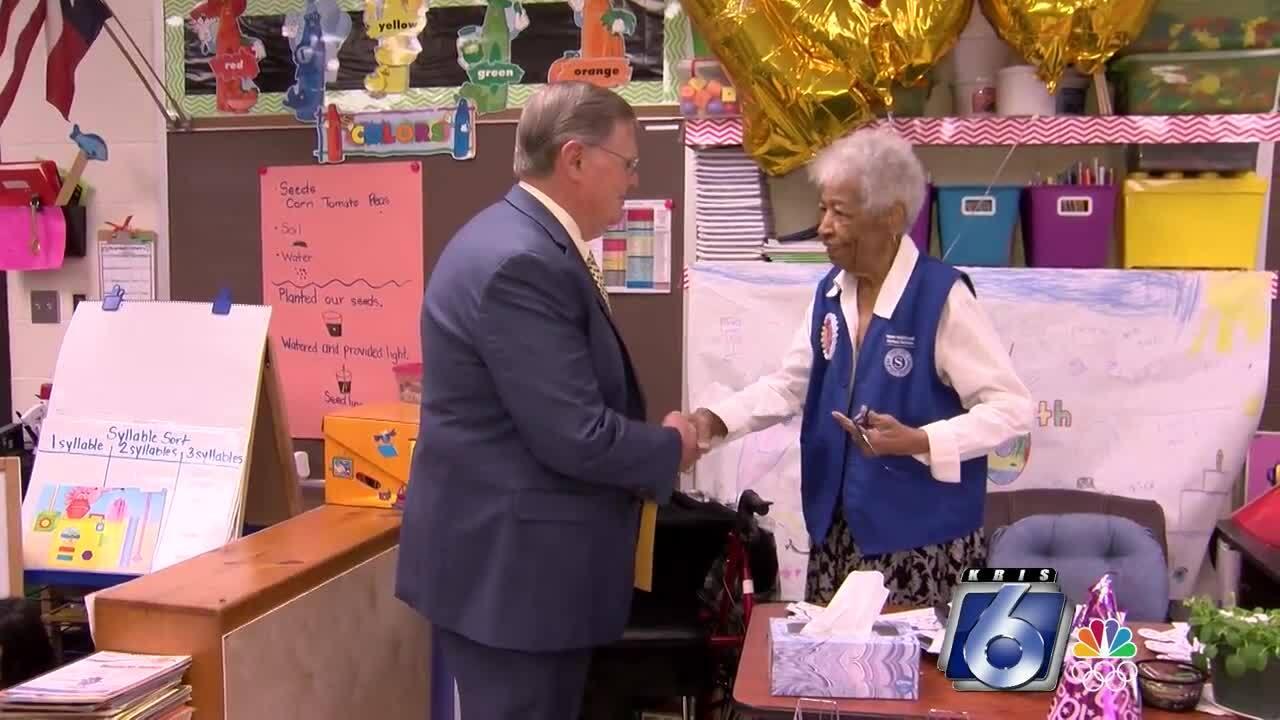 Mayor Joe McCombs congratulates Granny Davis on her 100th birthday