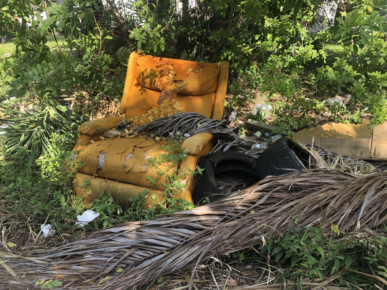 Tattered sofa chair illegally dumped in West Palm Beach