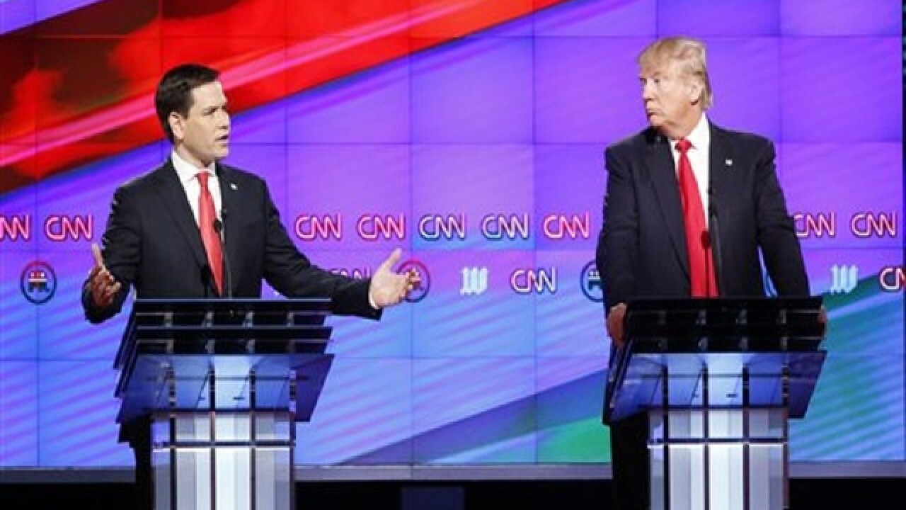 Trump, GOP rivals fight on in late debate