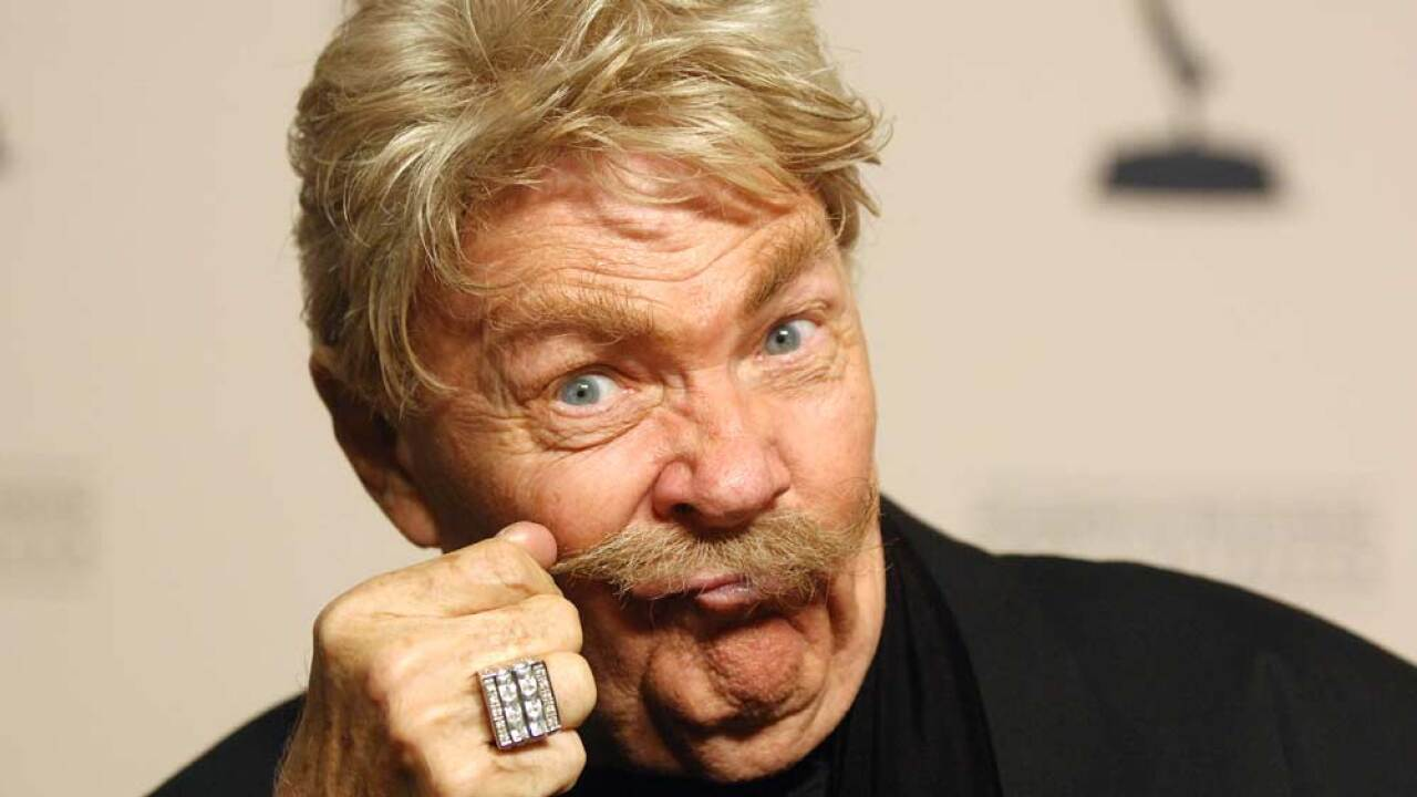 Rip Taylor poses for a picture at the premiere of 'Mitzi Gaynor: Razzle Dazzle! The Special Years' at the Leonard H. Goldenson Theatre November 13, 2008 in Hollywood, California.