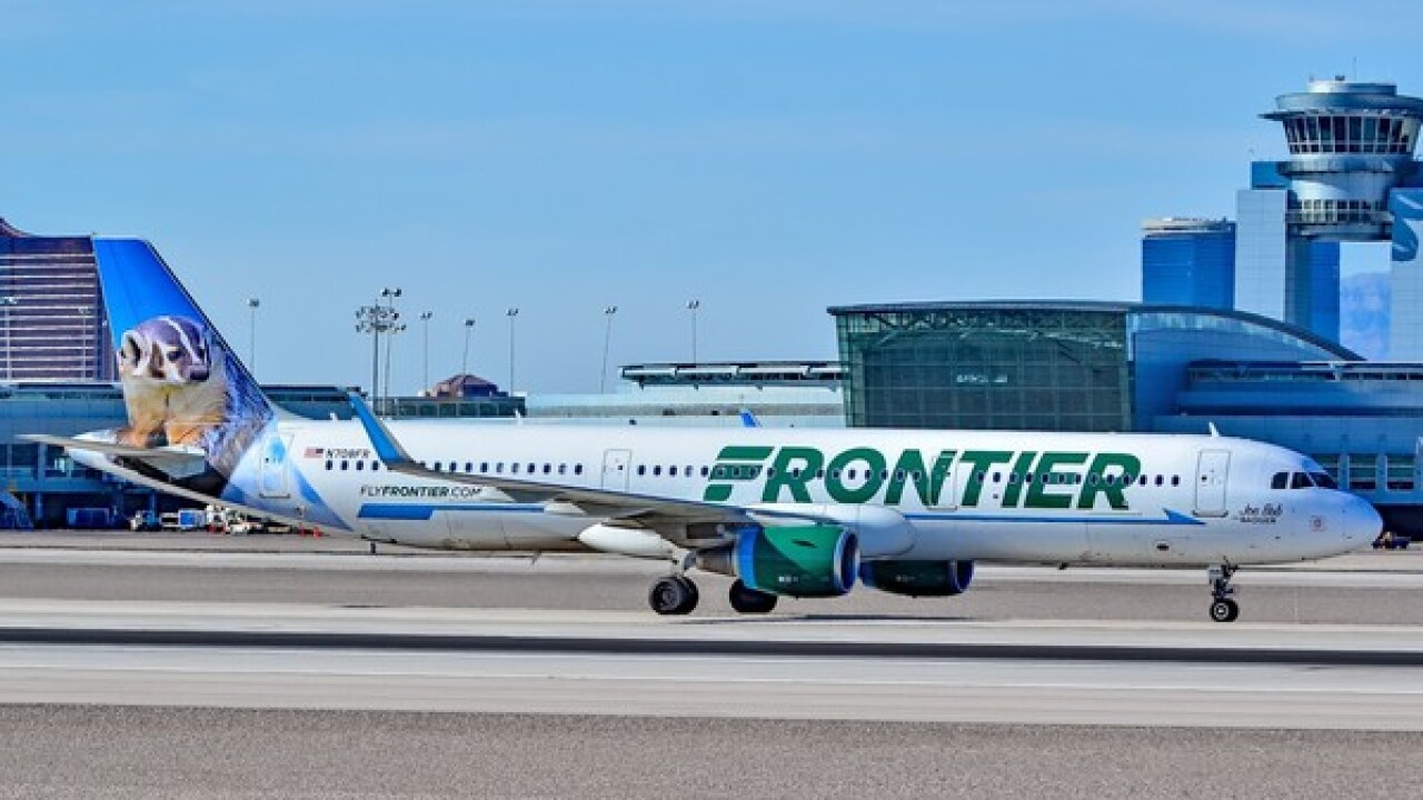 Man claims he was kicked off Frontier flight because of logo on his shirt
