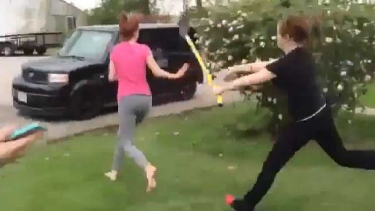 VIDEO: Two girls' crazy fight ends with a shovel to the head