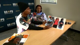 Brother and mother of Edward Morton hold pictures of him, Feb. 4, 2021