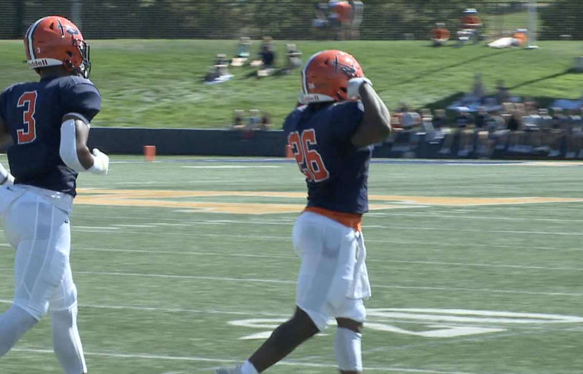 Kenyea Houston flexes after a touchdown