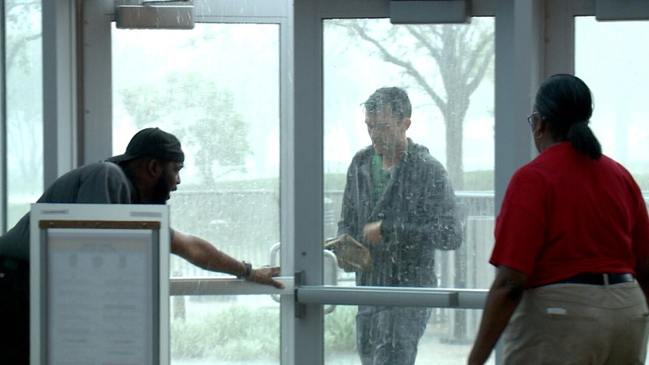 Festival goers seek fun and shelter at Virginia Beach Convention Center during Something in theWater