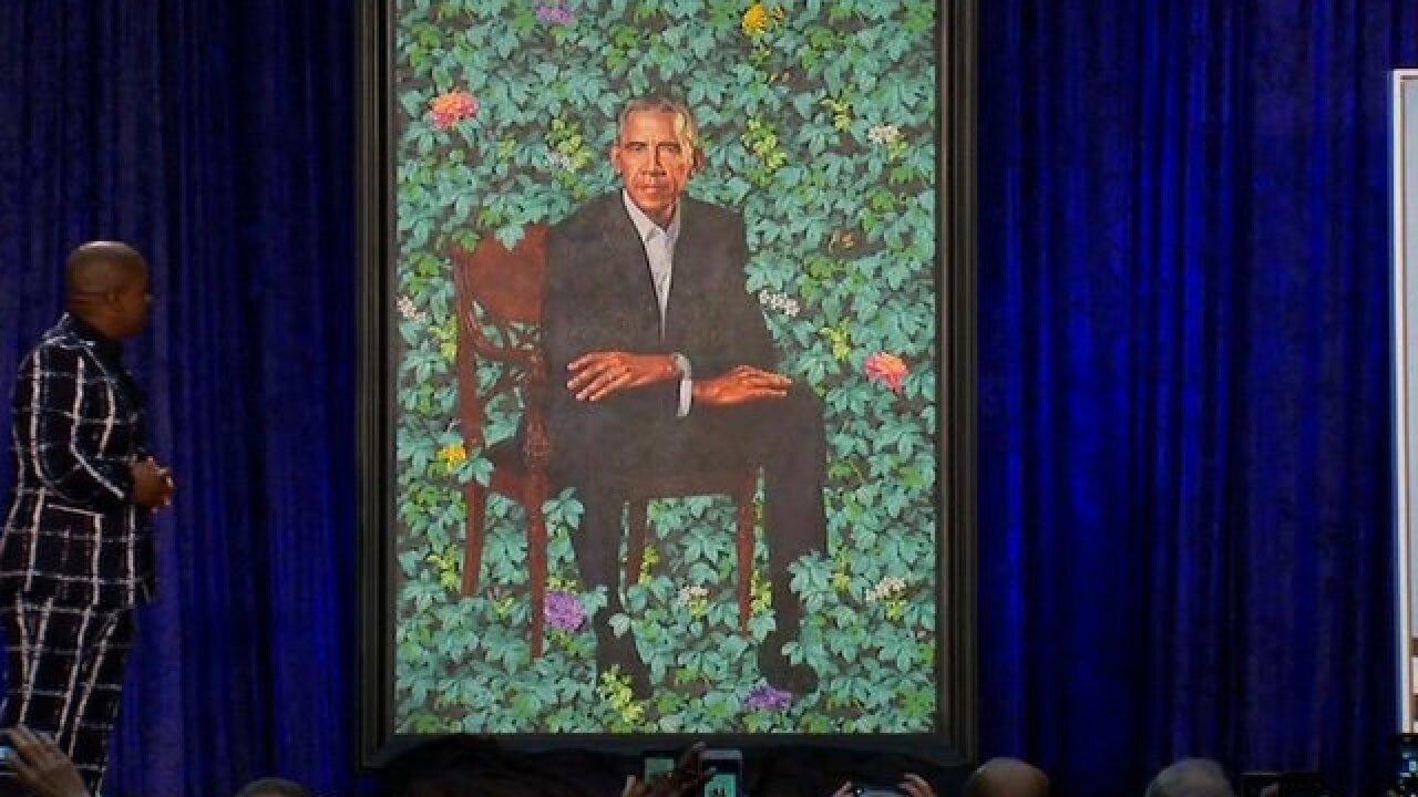 Obamas' official portraits unveiled