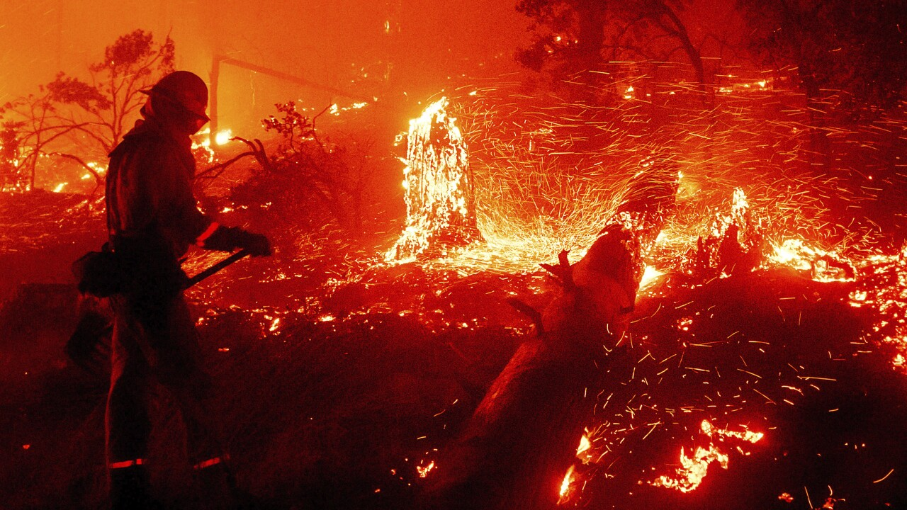 Dozens of people rescued by aircraft from path of California wildfire