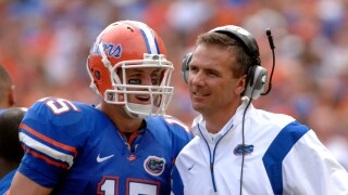 Tim Tebow and Urban Meyer smile together with Florida Gators in 2008