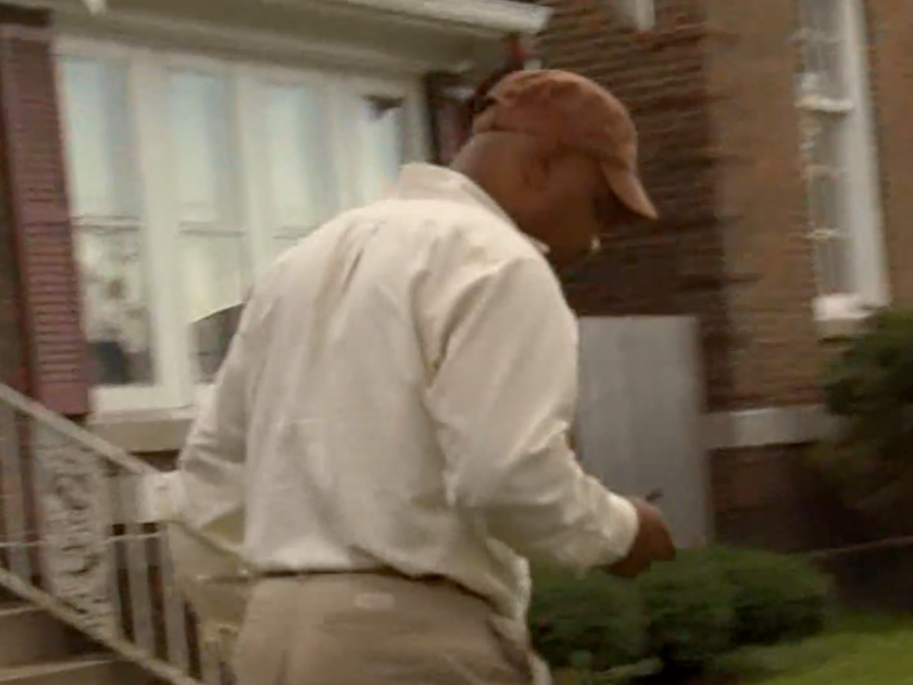 Elijah Rashaed walks away from a WTMJ-TV reporter in Milwaukee_cropped.png