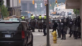 GRPD-riot-gear-Kent-County-Sheriff's-Office-deputies-on-horses-in-downtown-Grand-Rapids-after-7pm-curfew-June-1-2020.png