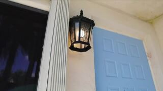 Karin Smith's blue front door with porch light turned on