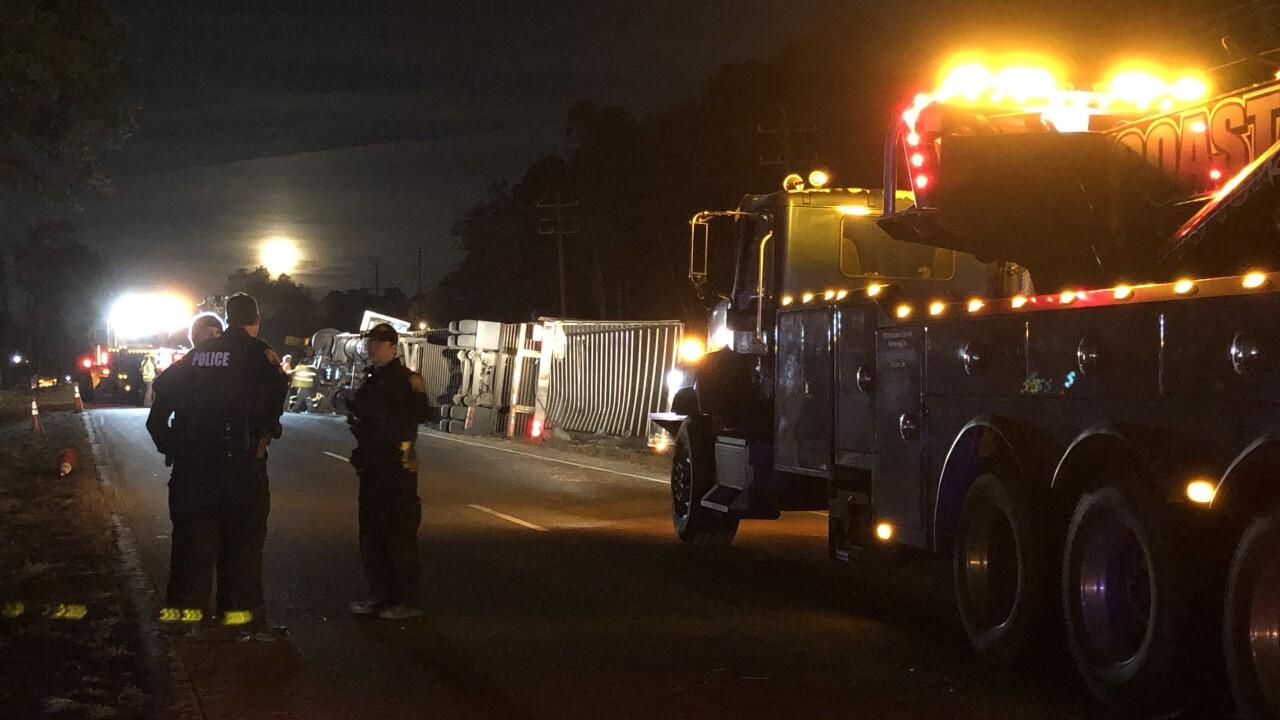 Tractor-trailer overturns on West HundredRoad