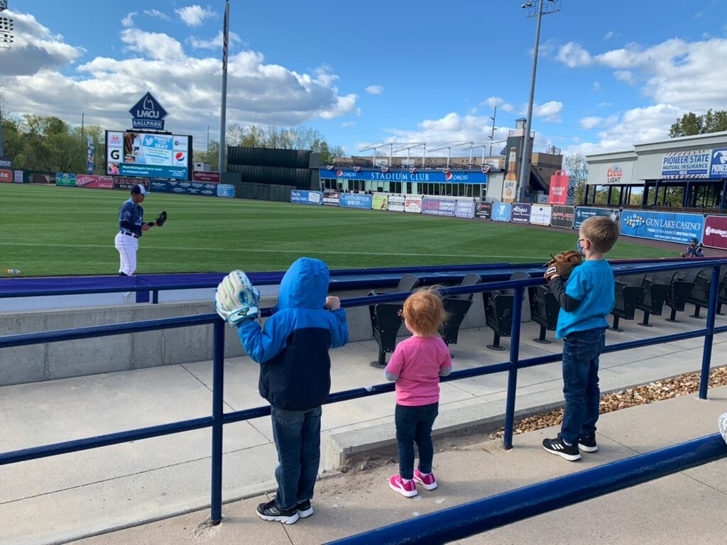 Young kids watch the Whitecaps warm up