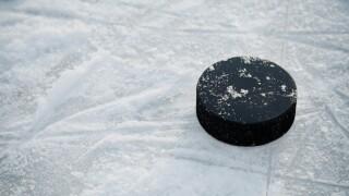 Hockey puck on ice hockey rink