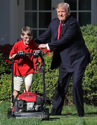 PHOTOS: 11-year-old cuts White House grass after writing to President Trump