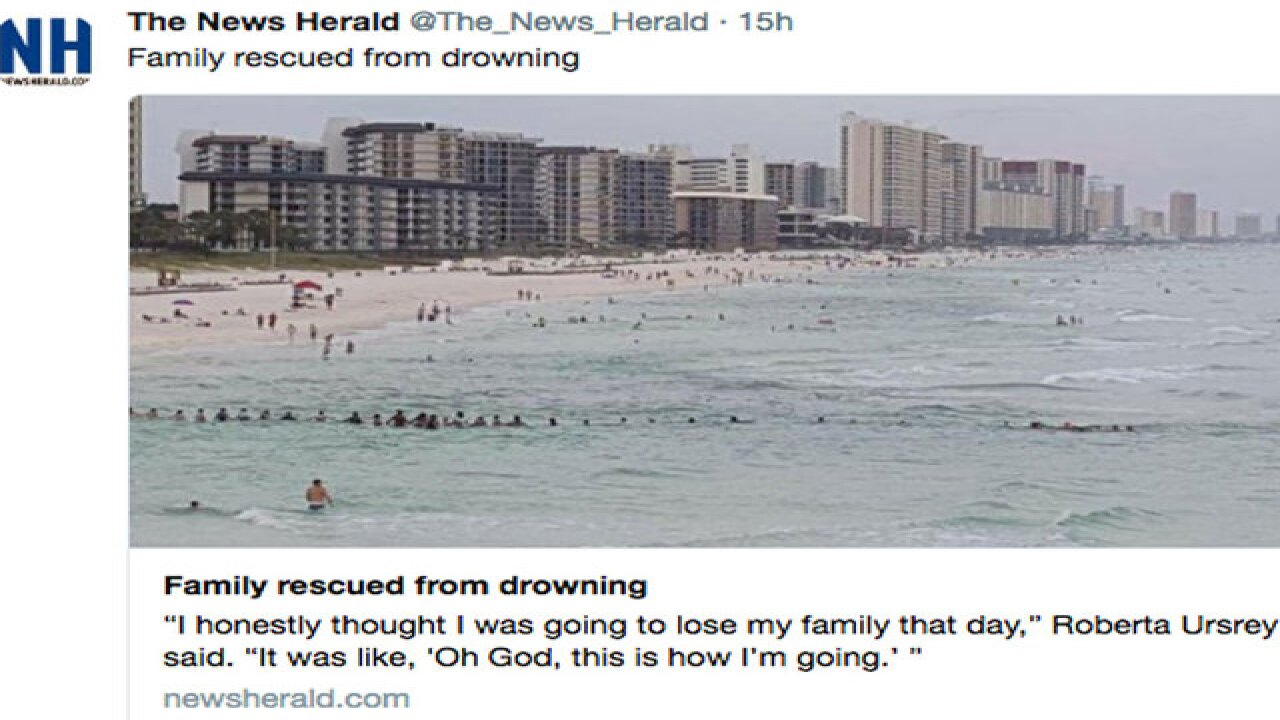 Beachgoers in Florida Panhandle form human chain to rescue family in water