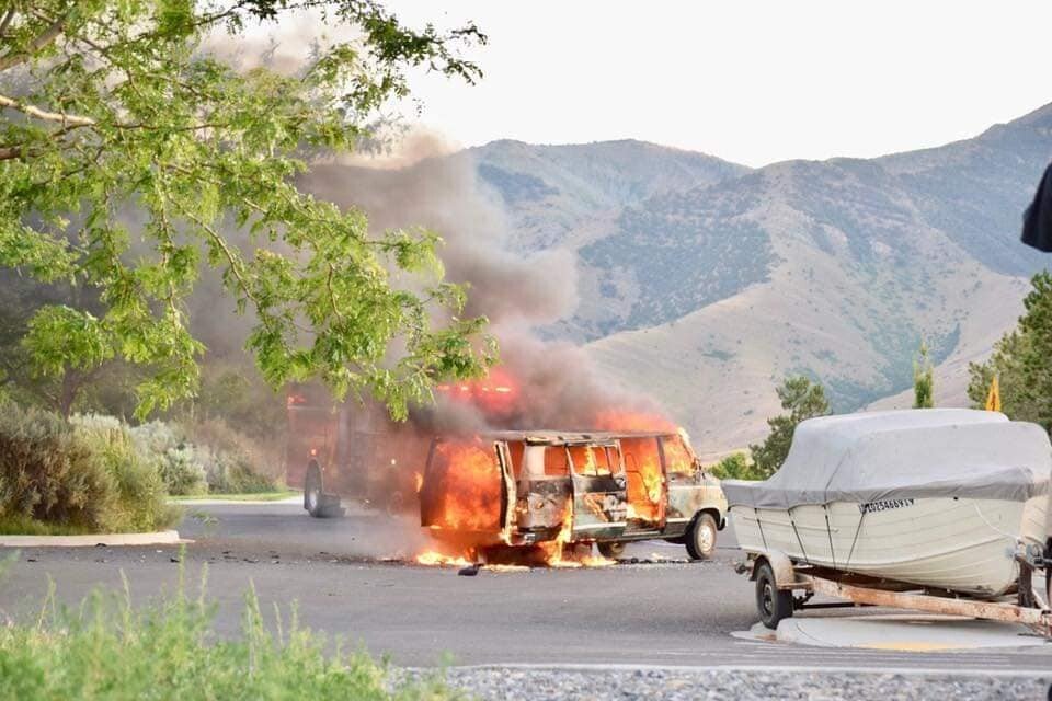 Photos: Family of five hospitalized after van bursts intoflames