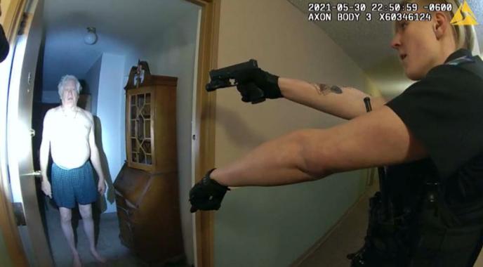 Ellie Summers pointing gun at Michael Clark