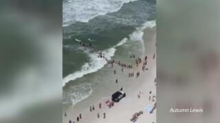 Human chain to rescue swimmers