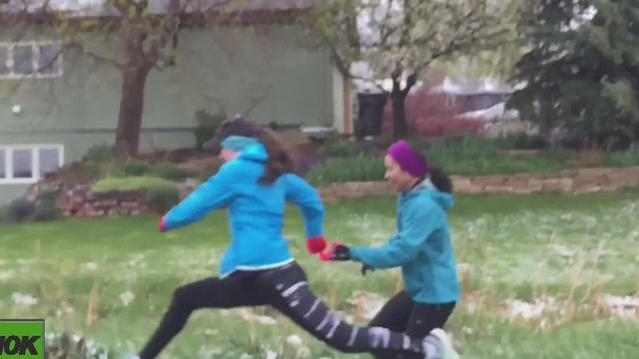 Blind runner uses guides to run Bolder Boulder