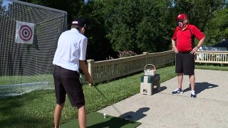 Golf coach helps kids work on their game.jpg