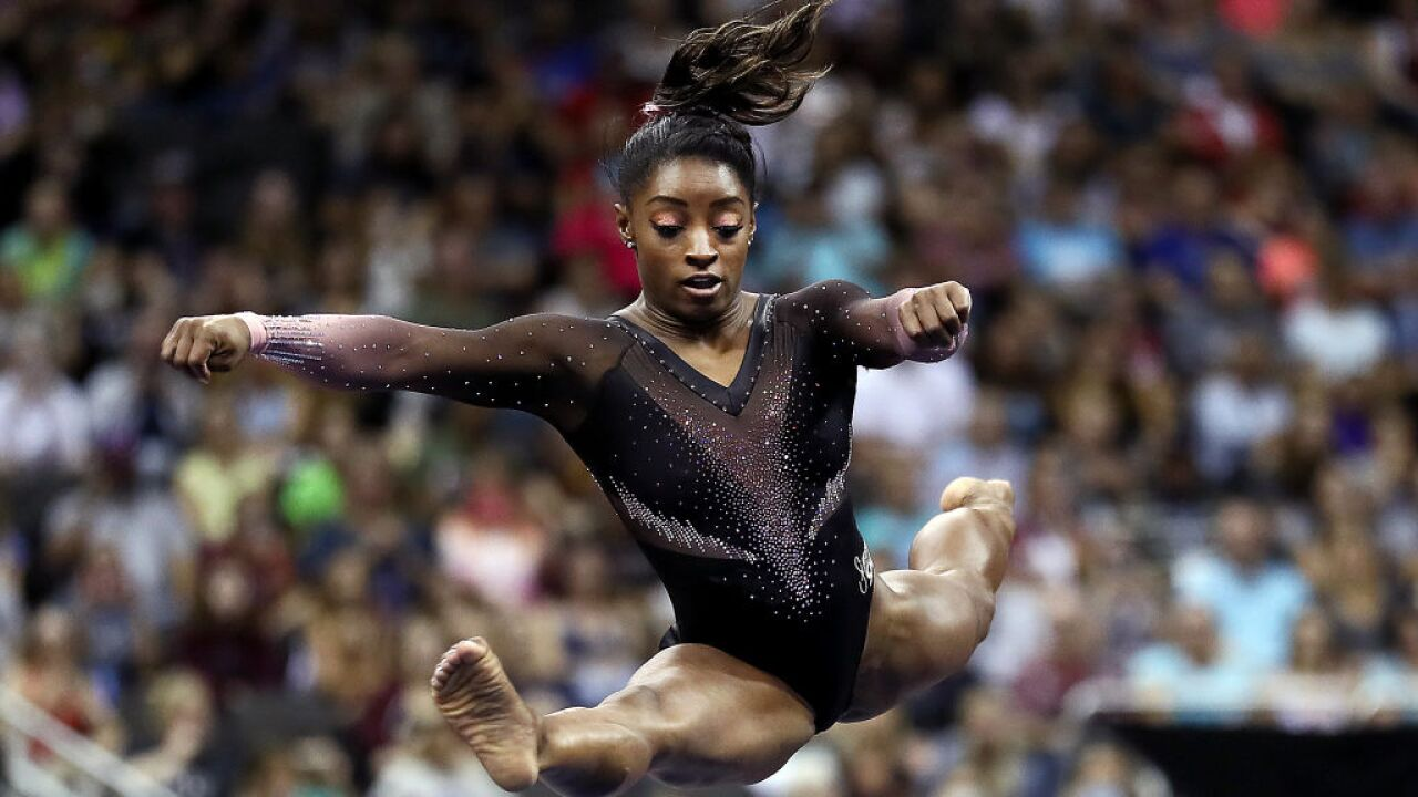 Simone Biles won her sixth national all-around title and landed a triple double