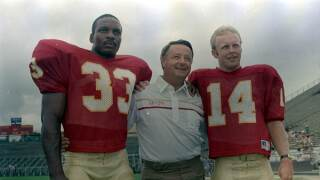 Florida State Seminoles head coach Bobby Bowden with arms around