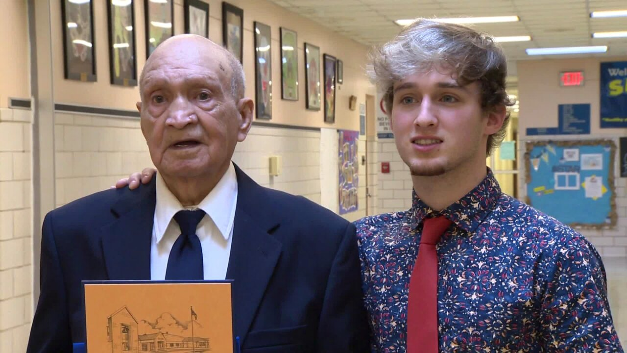 A 91-year-old WWII vet gets his high school diploma with his grandson
