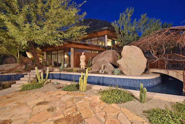 PHOTOS: Homes with luxurious pools listed for sale just in time for summer