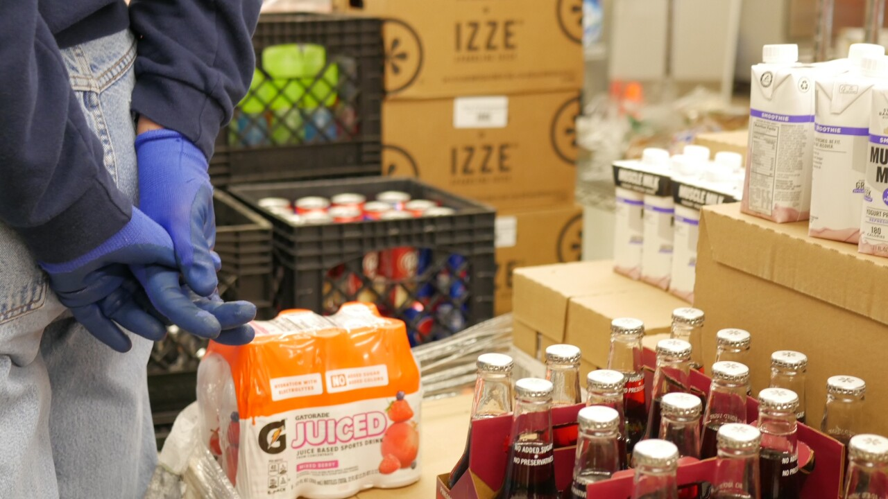Volunteers at Interchurch Food Pantry of Johnson County prepare boxed meals and deliver to cars