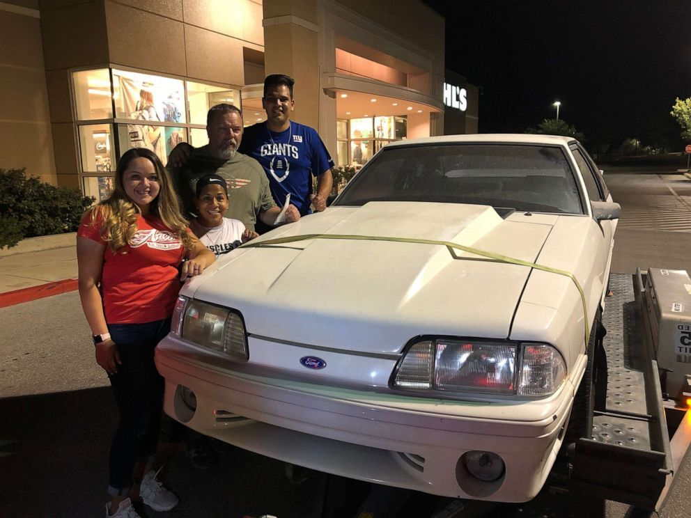 Wesley Ryan and Laura and their children Jake and Jeni of San Antonio, Texas, pose with his beloved 1993 white Ford Mustang GT in 2018 after Jake and Jeni bought the car back for their dad off Craigslist (Ryan Family).