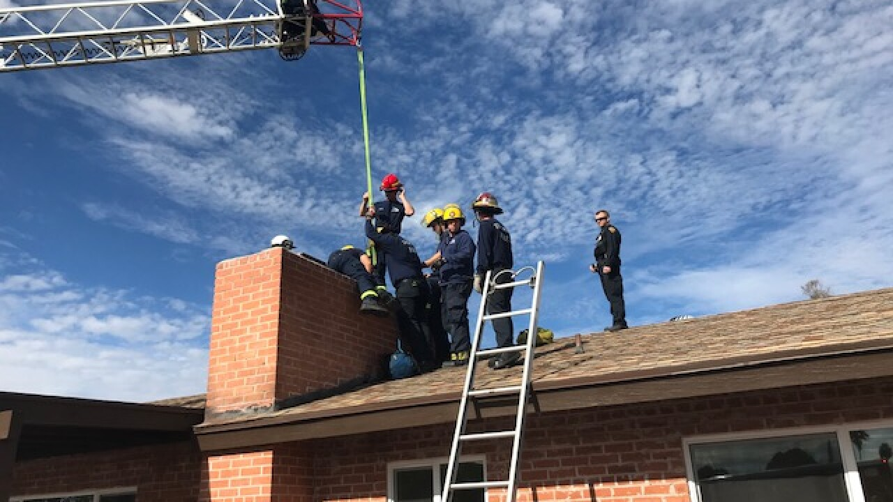 Tucson Fire Department rescued a man from a chimney in midtown Friday afternoon.